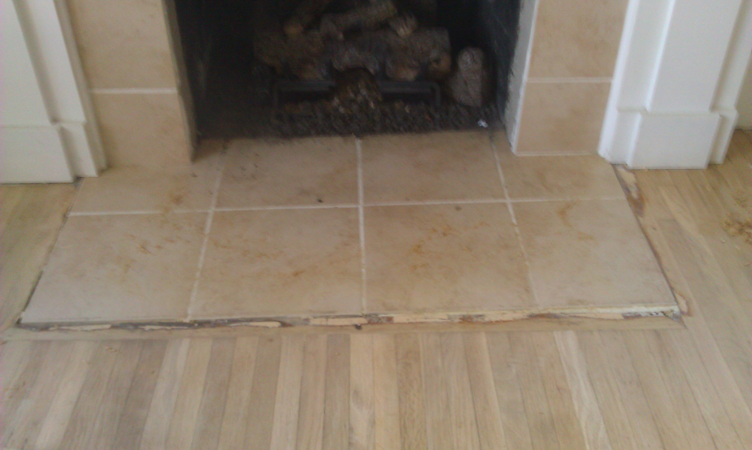 Flooring floor repairs hardwood floor handyman want for Floor hearth
